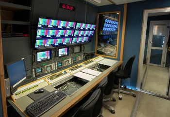 Reference 813   14-CAMERA SINGLE-EXPANDING HD OB TRUCK   Engineering section with 3x Sony BVM-A14F5A 14″ monitors, 3x Tektronix WFM601M waveform monitors, 3x DK Technologies PM5661 vector scopes