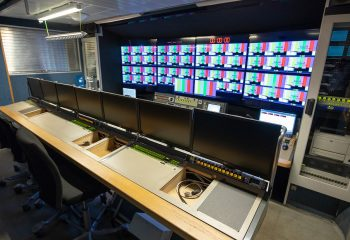 Reference 813   14-CAMERA SINGLE-EXPANDING HD OB TRUCK   Production area with Grass Valley XTEN 4 ME 54-input HD vision mixer. EVS section at the back.