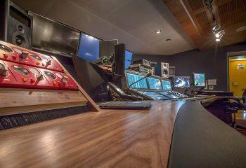 A desk-height view across H Studio's new audio control room